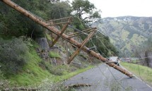 Utility pole blocks road after storm