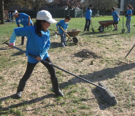 Youngsters helped out, including raking mulch.